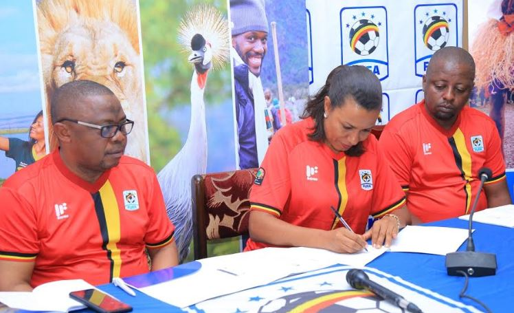 UTB CEO, Lilly Ajarova signs the MoU with FUFA to promote sports tourism.