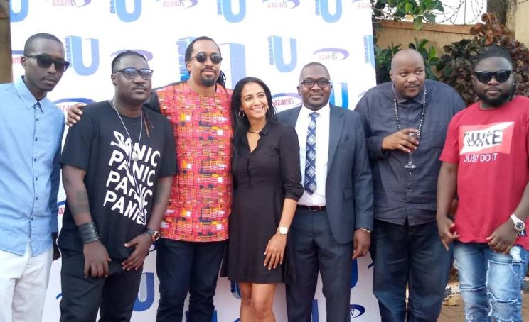 Musicians pose for a photo with a team from Azam TV during the launch of their new channel held at their offices in Kololo.