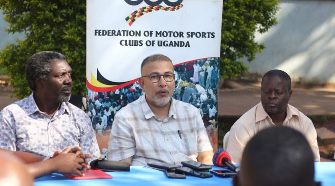Federation of Motorsport Clubs of Uganda President, Dipu Ruprelia(c) addresses media. Looking on is Jimmy Akena(L), the President Uganda Motocross Club